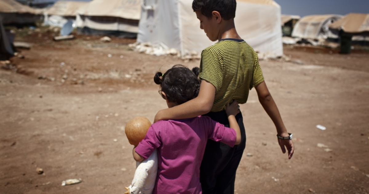 Syrian refugee children walk in the Bab al-Salam refugee camp in Syria's northern city of Azaz on July 15, 2013. The Syrian war has created the worst refugee crisis since the 1994 Rwandan genocide, UN officials say.</p>