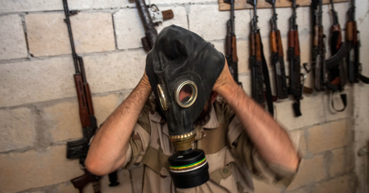 A Syrian rebel tries on a gas mask seized from a Syrian army factory in the northwestern province of Idlib on July 18, 2013. Western countries say they have handed over evidence to the UN that Bashar al-Assad's forces have used chemical arms in the two-year conflict. More than 100,000 people have died in the conflict, which morphed from a popular movement for change into an insurgency after the regime unleashed a brutal crackdown on dissent.</p>