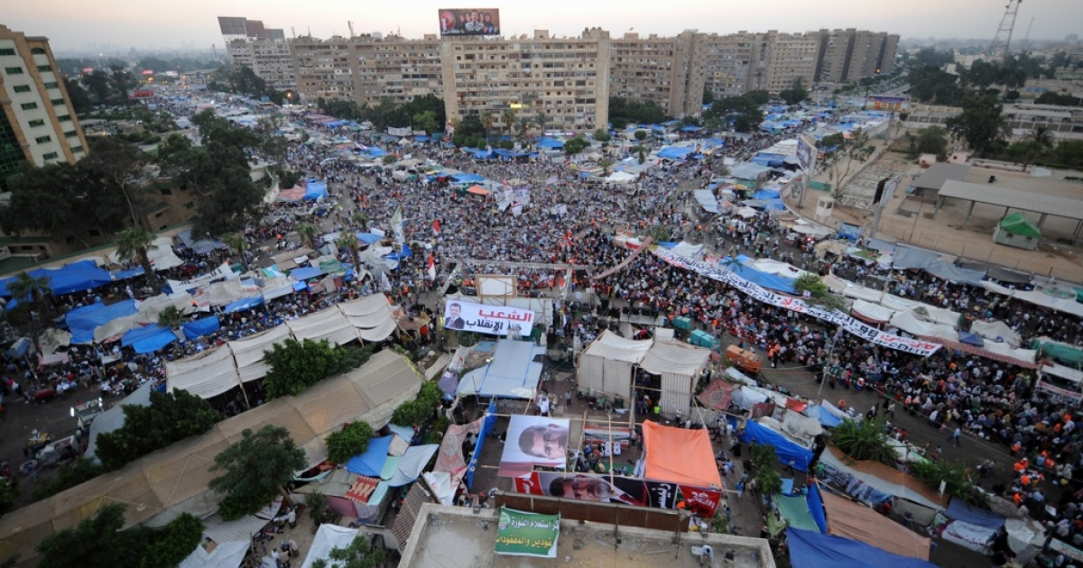 Supporters of deposed Egyptian president Mohamed Morsi hold a sit-in outside Rabaa al-Adawiya mosque on July 25, 2013 in Cairo.</p>