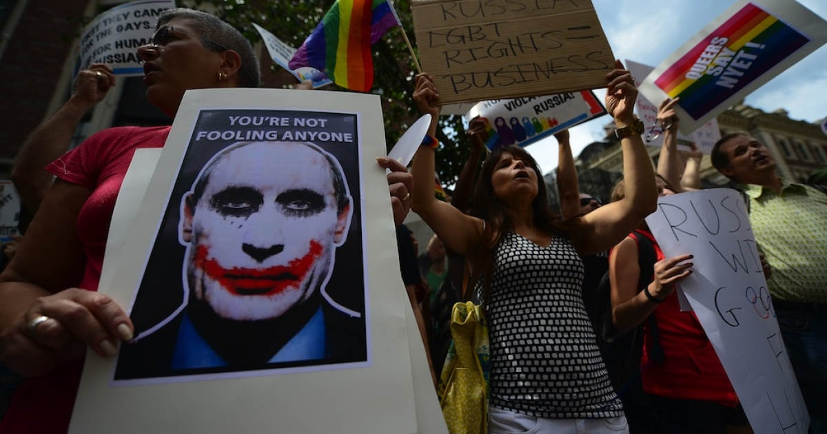 Protesters hold a demonstration against Russian anti-gay legislation and against Russian President Vladimir Putin stands on gay rights, in front of the Russian Consulate in New York, July 31, 2013.</p>