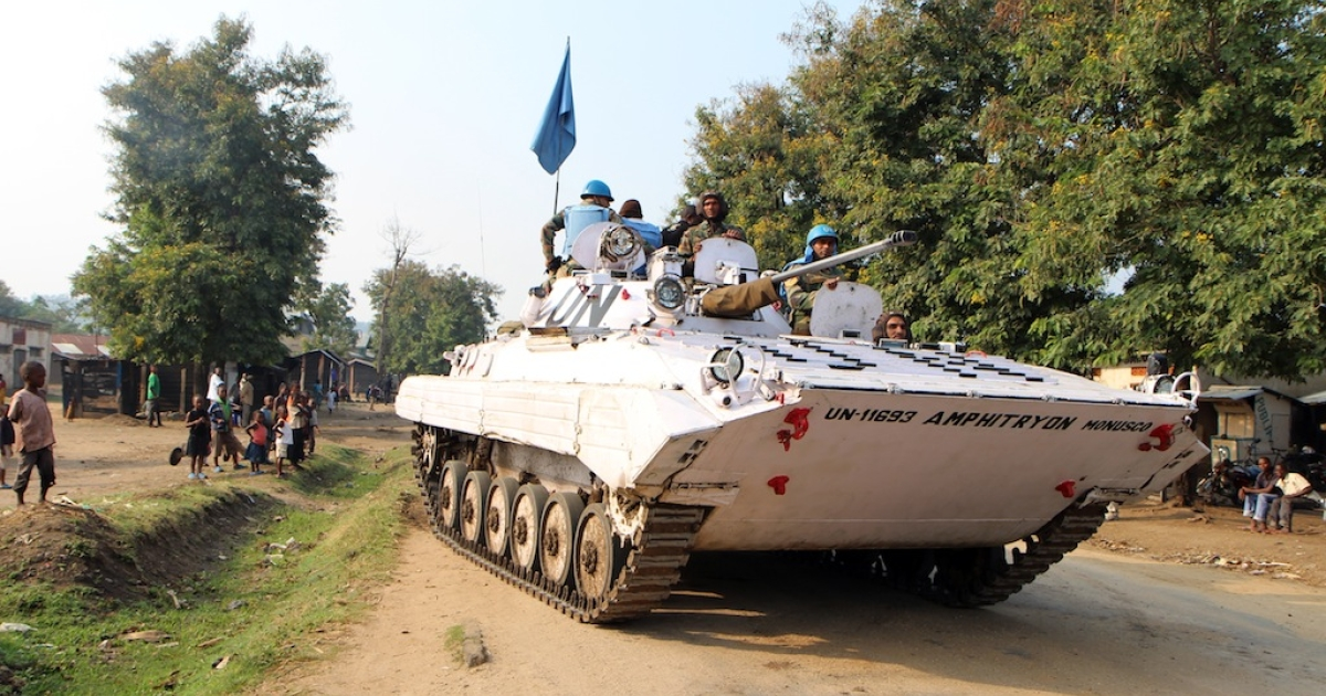 Peacekeepers from the MONUSCO mission in the Democratic Republic of Congo patrol the town of Kiwanja, a town controlled by the M23 rebels, some 40 miles north of Goma, on August 4, 2013.</p>