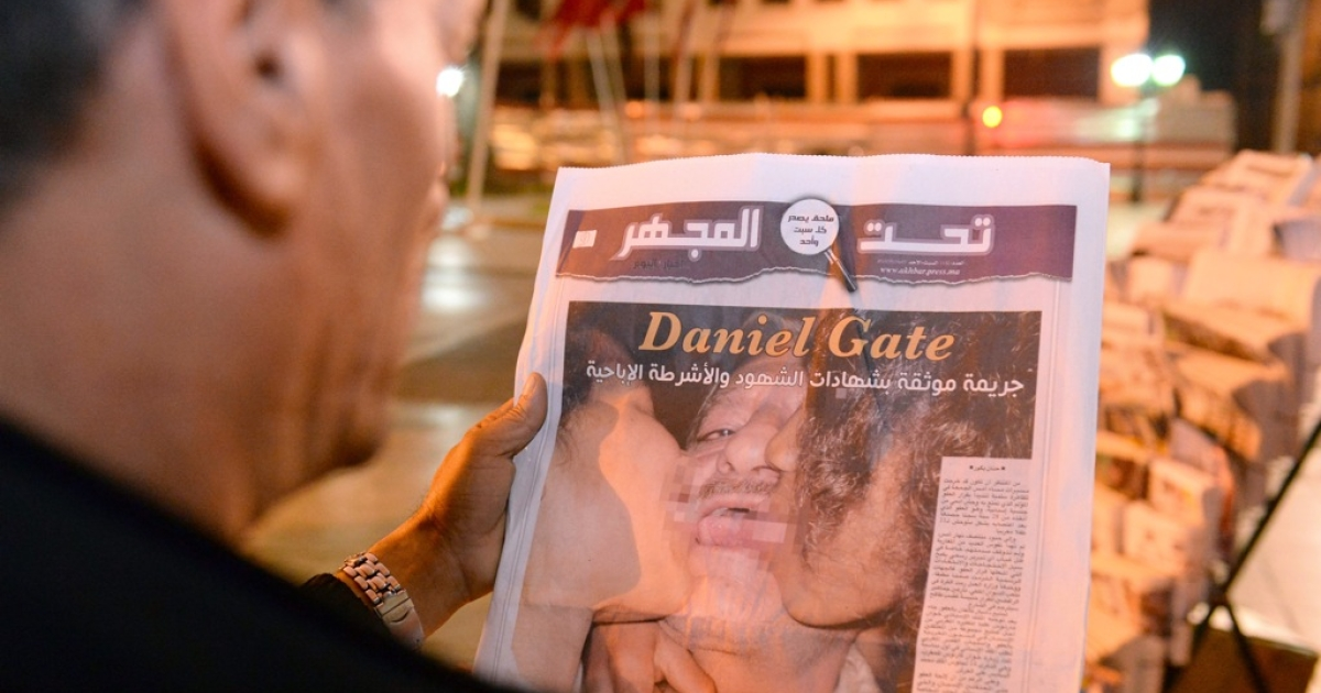 This photo taken on August 5, 2013 shows a man in Rabat reading about a Spanish pedophile who raped 11 local children. Spanish police have arrested convicted pedophile Daniel Galvan Vina, who had his pardon revoked by Morocco's King Mohamed VI after it sparked angry protests in the north African country.</p>