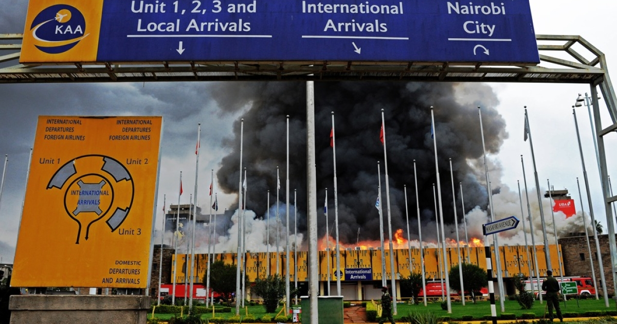 The burning Jomo Kenyatta international airport on August 7, 2013. A massive fire shut down Nairobi's international airport with flights diverted to regional cities as firefighters battled to put out the blaze in east Africa's biggest transport hub.</p>