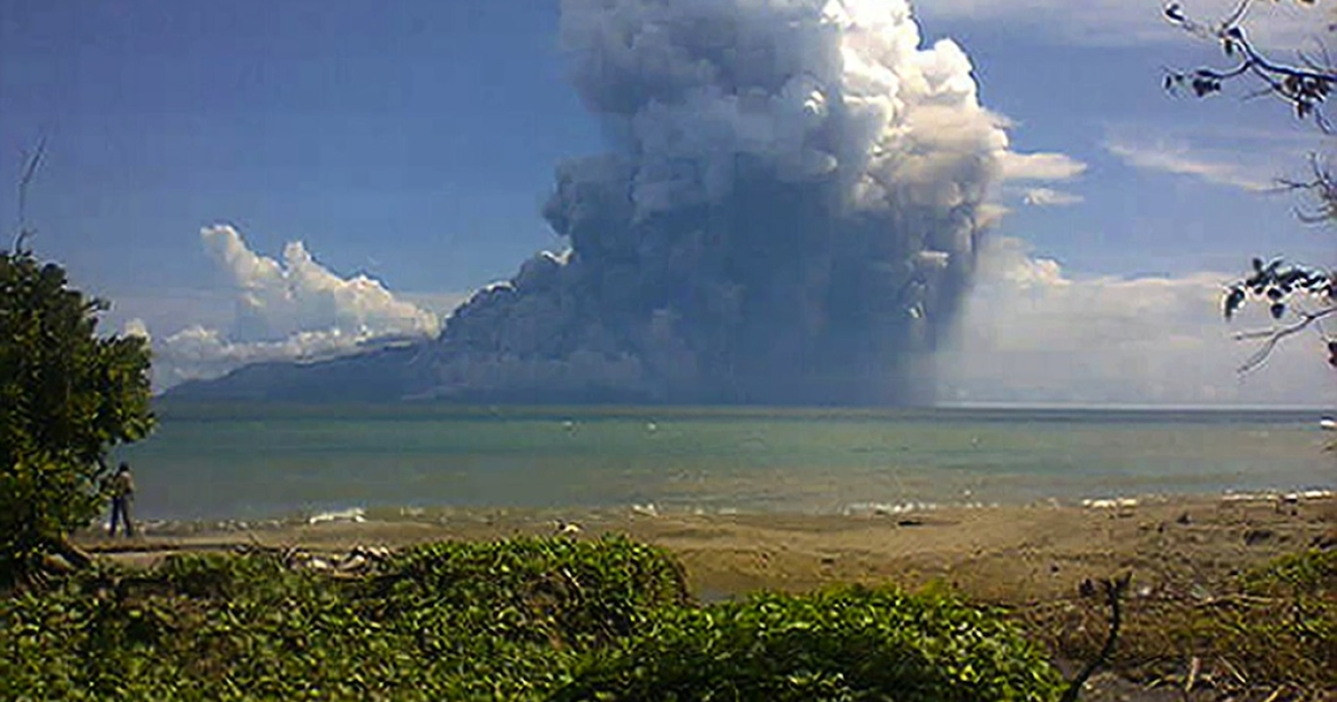 The photo taken from the Maurole district of East Nusa Tenggara province with a camera phone shows Mount Rokatenda volcano spewing a huge column of hot ash during an eruption on August 10, 2013.</p>