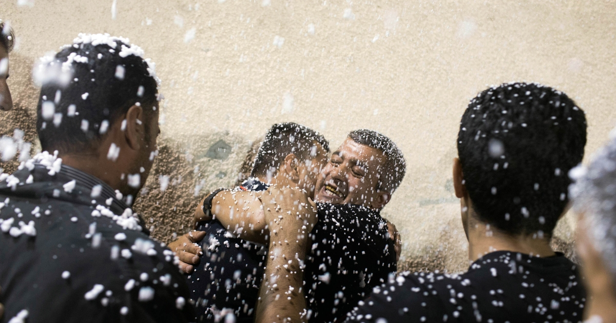 August 14, 2013- Families celebrate the release of 11 Palestinian prisoners from an Israeli jail in the Mikatah compound in Ramallah, West Bank. Officials said on Dec. 30 that Israel was set to release another 26 Palestinian prisoners in the third of the four-stage release agreed upon in peace talks.</p>