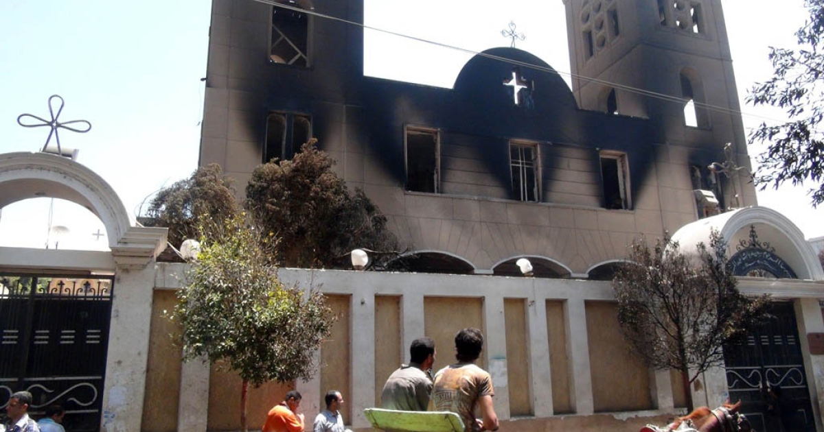 A picture taken on August 14, 2013, shows the facade of the Prince Tadros Coptic church after being torched by unknown assailants in the central Egyptian city of Minya. Egypt's Christians are living in fear after a string of attacks against churches, businesses and homes they say were carried out by angry supporters of ousted Islamist president Mohamed Morsi.</p>