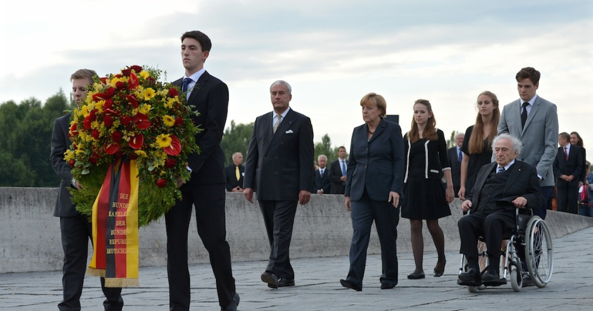 German Chancellor Angela Merkel lays a wreath while visiting the Dachau concentration camp memorial on August 20, 2013 in Dachau, Germany. Merkel's visit is the first by an acting German chancellor to the memorial of the notorious former concentration camp. Built by the Nazis, Dachau held 200,000 political prisoners, Jews, homosexuals and others whom the Nazis deemed as worthy of persecution, and 43,000 died before U.S. soldiers liberated the camp in 1945.</p>