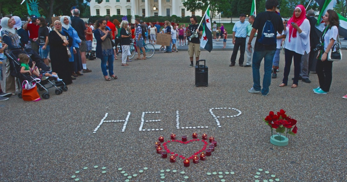 Demonstrators calling for help from US President Obama on the Syrian revolution protest in front of the White House late August 21, 2013, in Washington, DC.</p>