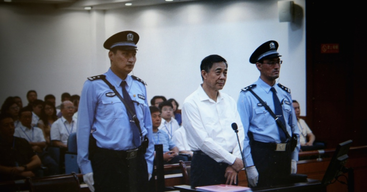 A screen shows a picture of the trial of disgraced Chinese politician Bo Xilai (C) shown at a press conference in Jihua Hotel on August 22, 2013 in Jinan, China. Bo is standing trial on charges of bribery, corruption and abuse of power.</p>