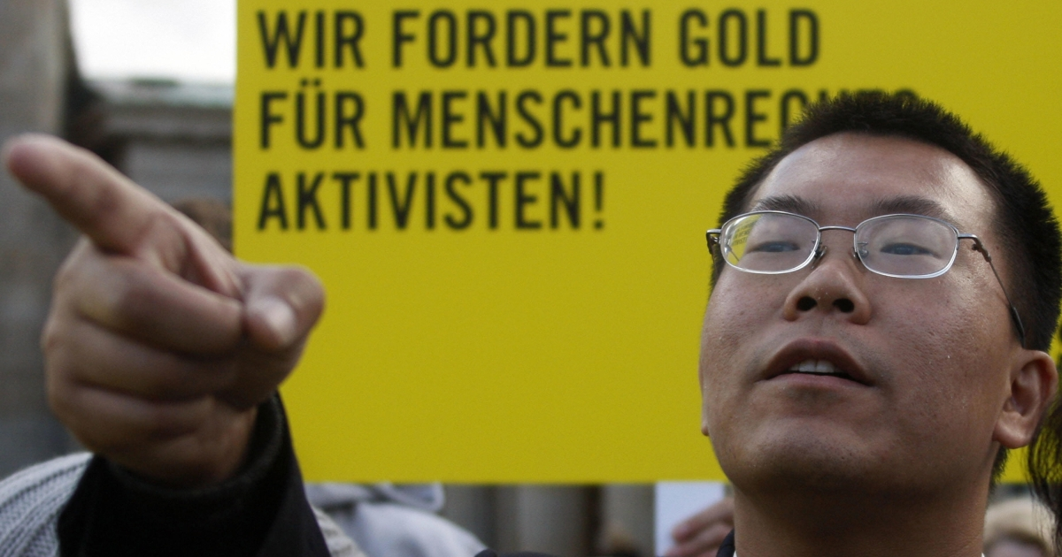 Chinese human rights lawyer Biao Teng gestures during a demonstration by activists from the German chapter of Amnesty International in Berlin 07 December 2007. Mr. Teng speaks to GlobalPost in an exclusive interview.</p>