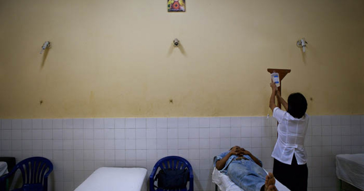 Manuel Silva, 42, terribly sick with high fever, being tested for malaria at a clinic in Iquitos, Peru. Fortunately, the test turned up negative.</p>