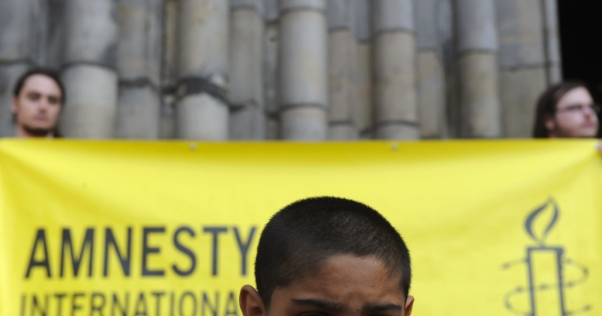 A Roma boy is pictured at a rally against extremism and neo-Nazism on May 3, 2009 in Prague.</p>