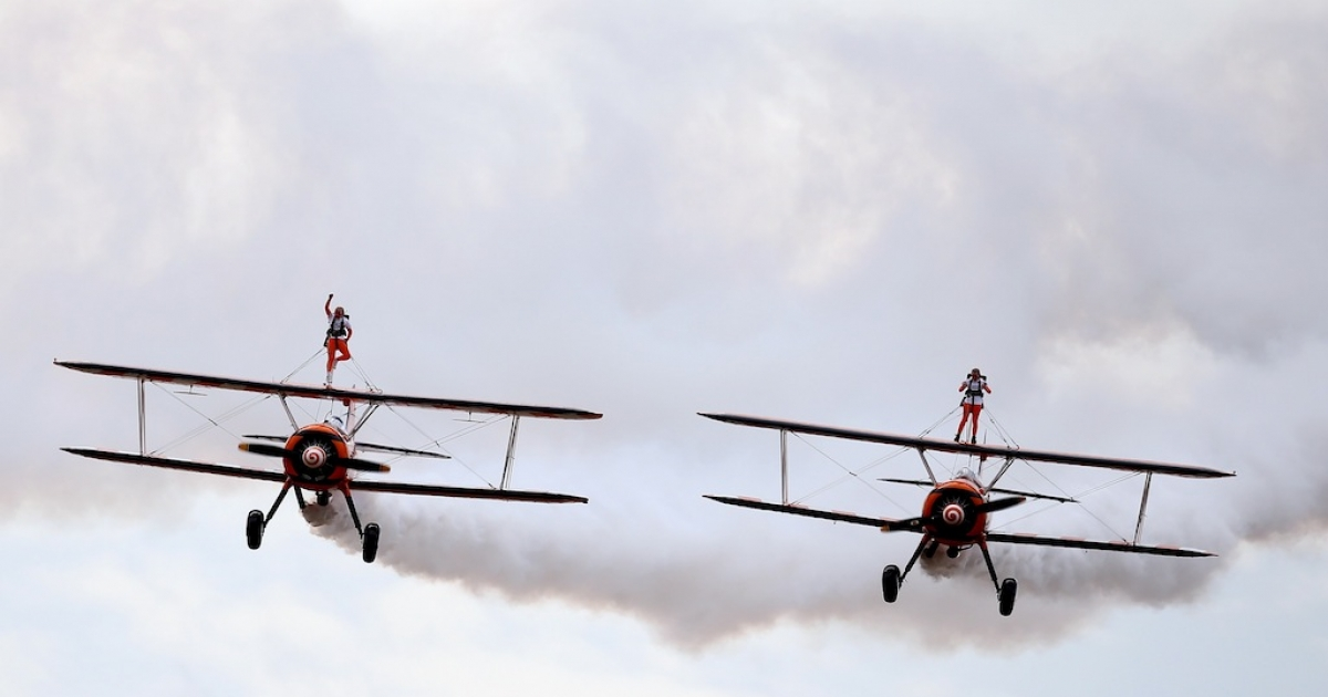 Nine-year-old cousins Rose Powell, left, and Flame Brewer wing-walk over Rendcomb airfield in Gloucestershire, England, on Aug. 21, 2013 in an attempt to become the world's youngest formation wing-walkers.</p>