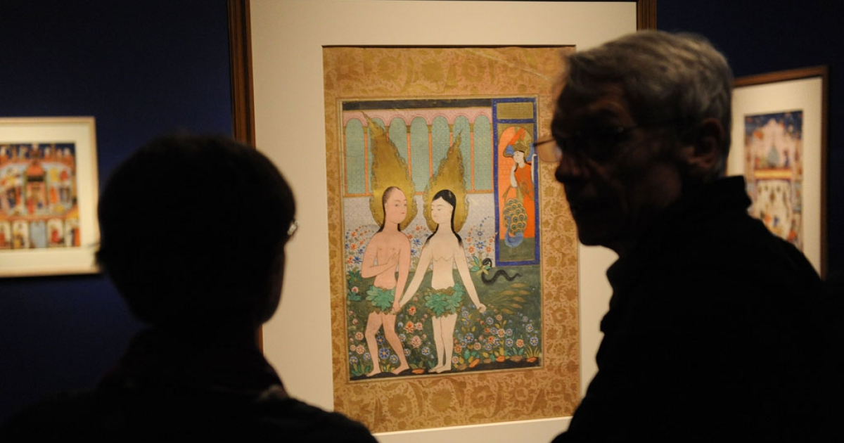Patrons view an early 17th century Ottoman painting of Adam and Eve at the Smithsonian Sackler Gallery of Art on October 27, 2009 in Washington.</p>