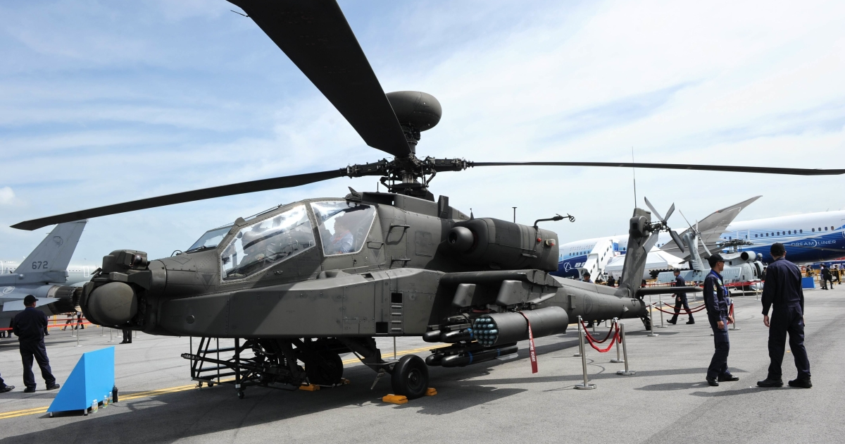 A Boeing AH-64D Apache helicopter is displayed at the Singapore Airshow in Singapore on Feb. 14, 2012. The US has agreed to sell Indonesia eight AH-64E Apaches for $500 million.</p>