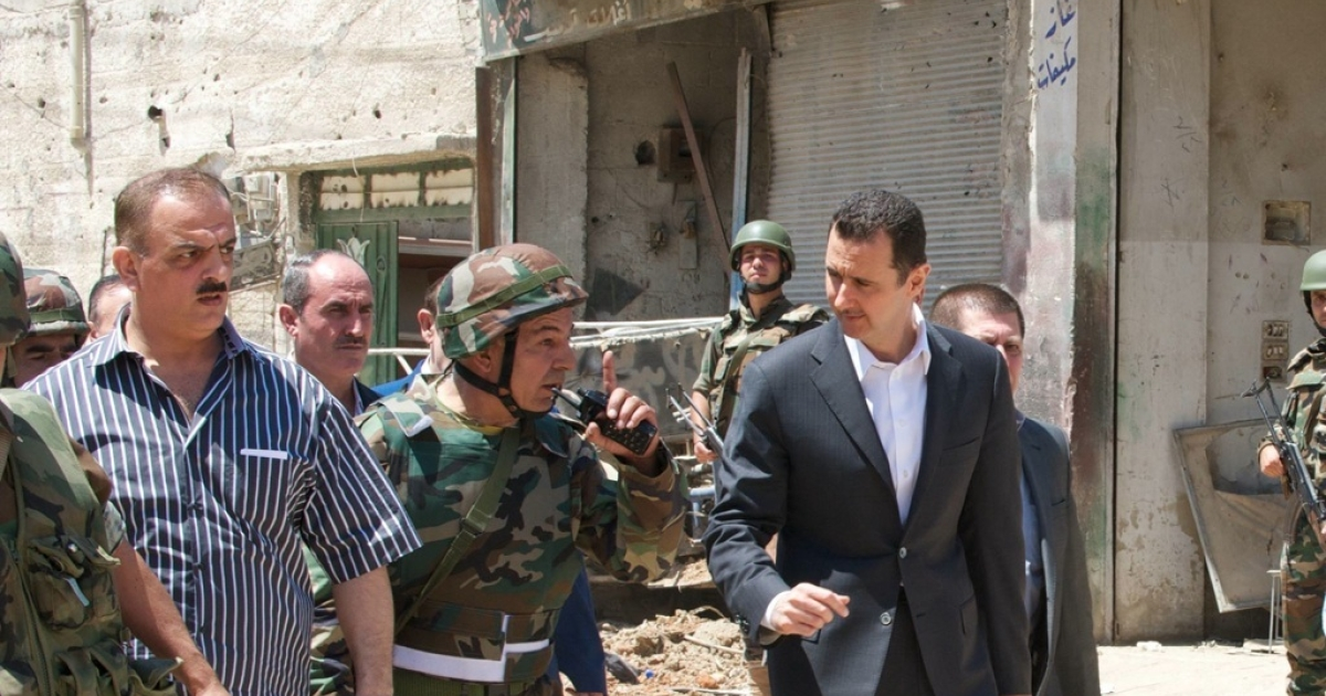 This photo from the Syrian Presidency's Facebook page shows Bashar Assad meeting troops on Army Day, Aug. 1, 2013.</p>