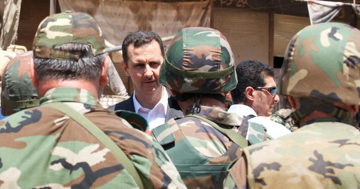 This photograph from the Syrian Presidency's Facebook page shows Bashar Assad meeting troops on Army Day, Aug. 1, 2013.</p>
