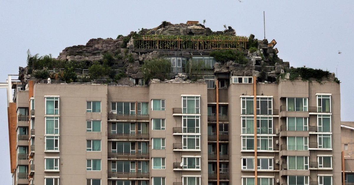 The luxury rooftop apartment is covered by fake rocks, trees and bushes. It faces demolition in 15 days.</p>