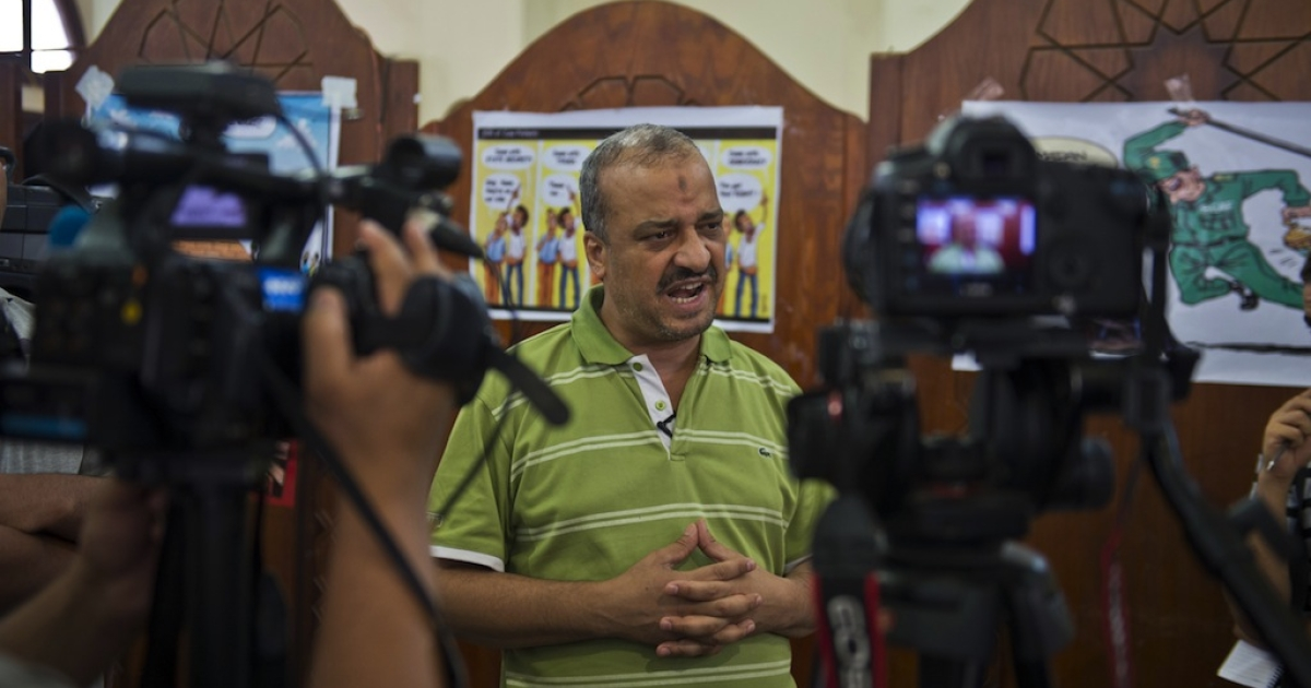 A picture taken August 4, 2013 shows Egypt's Muslim Brotherhood leader Mohamed al-Beltagi talking with foreign media during an interview at the Rabaa al-Adawiya mosque in Cairo. Beltagi is the latest top-ranking member of the Brotherhood to be arrested for inciting violence.</p>