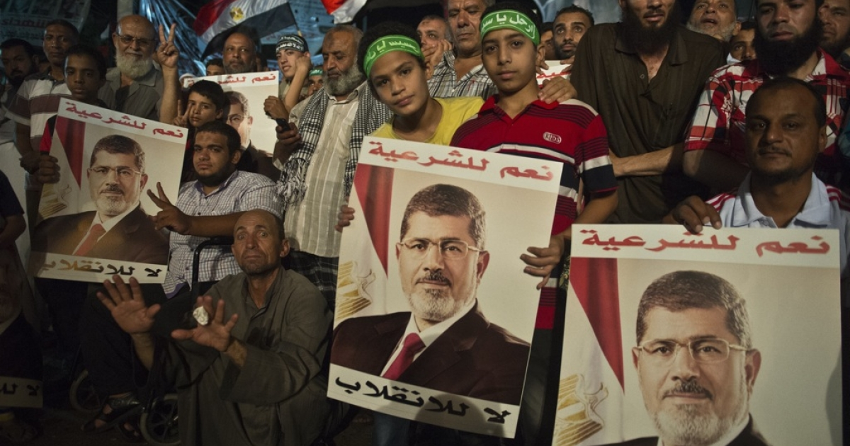 Supporters of Egypt's deposed president Mohamed Morsi gather during a sit-in outside Rabaa al-Adawiya mosque in Cairo on August 1, 2013.</p>