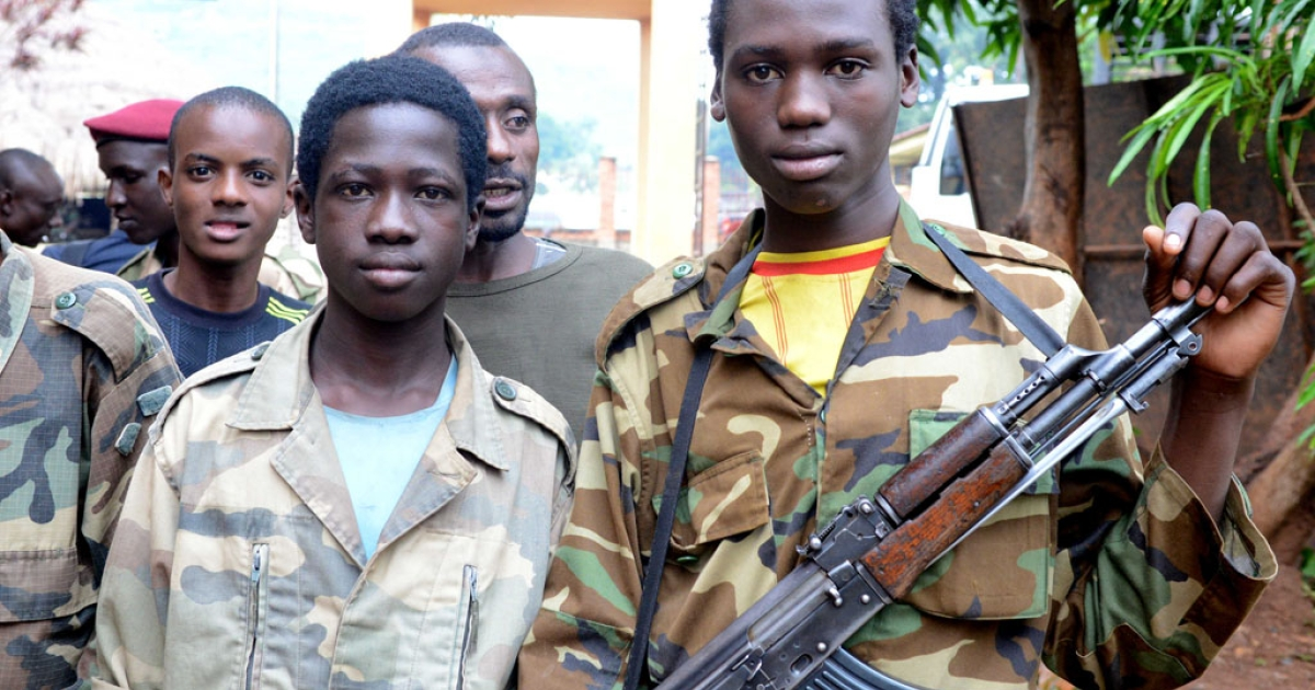 Young Seleka fighters pose on July 25, 2013, at the Bangui firefighters barracks, turned into a Seleka base, in the Central African Republic.</p>