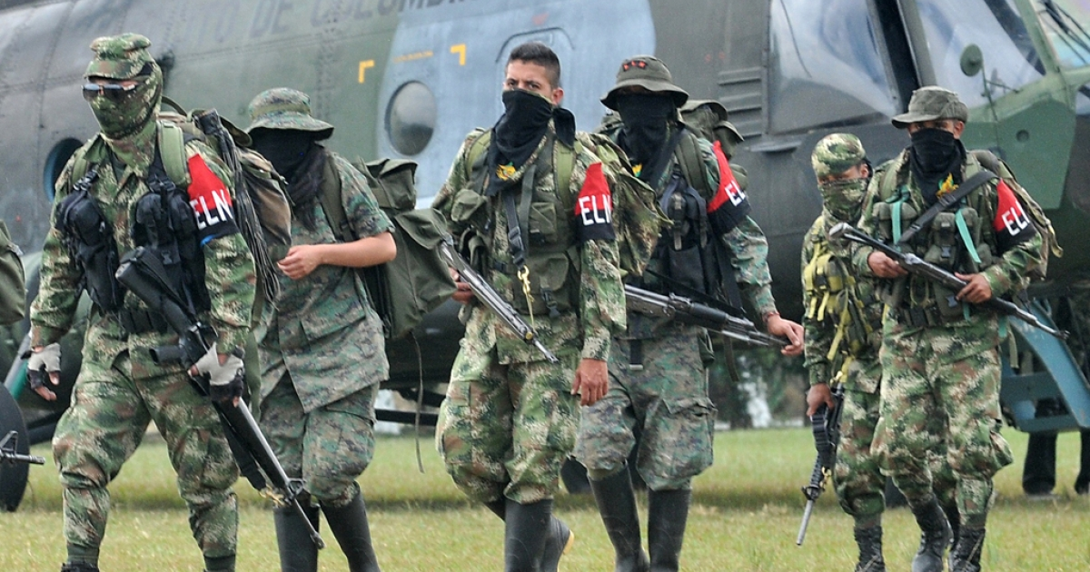 Demobilized members of the ELN (National Liberation Army) arrive in Cali, Colombia, on July 16, 2013. Thirty members of the ELN surrendered with their weapons.</p>
