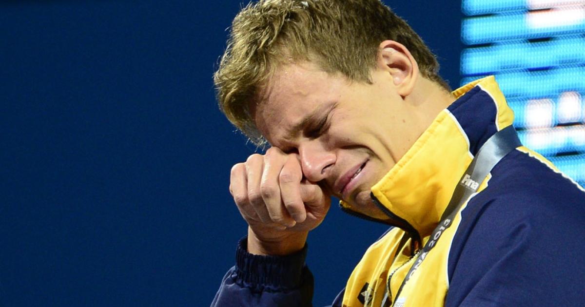 Brazil's Cesar Cielo Filho wipes away tears during an award ceremony for the men's 50-metre freestyle gold at the world swimming championships in Barcelona on August 3, 2013.  While Filho's tears are those of joy, new research suggests men and women are depressed in equal numbers, although men are less likely to show their emotions.</p>