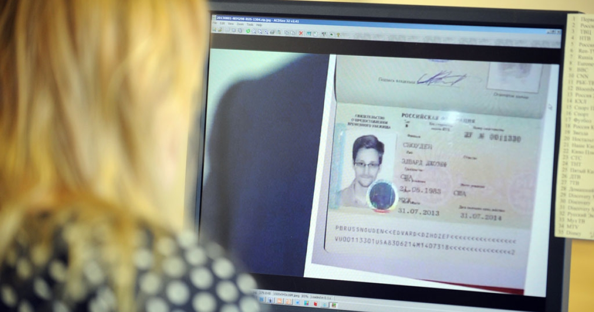 A woman in Moscow watches footage on her computer showing US intelligence leaker Edward Snowden on Aug. 1, 2013.</p>
