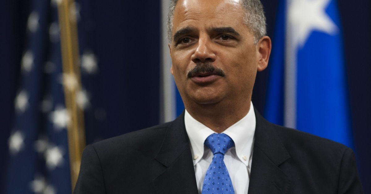 Attorney General Eric Holder speaks during a farewell ceremony in honor of outgoing Federal Bureau of Investigation (FBI) Director Robert Mueller at the Department of Justice on Aug. 1, 2013.</p>
