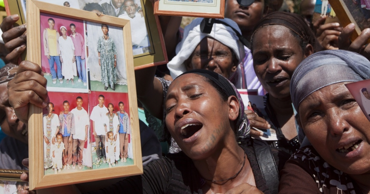 Israelis from the Ethiopian community hold photographs of their relatives during a protest outside Prime Minister Benjamin Netanyahu's office in Jerusalem on Aug. 28, 2013.</p>