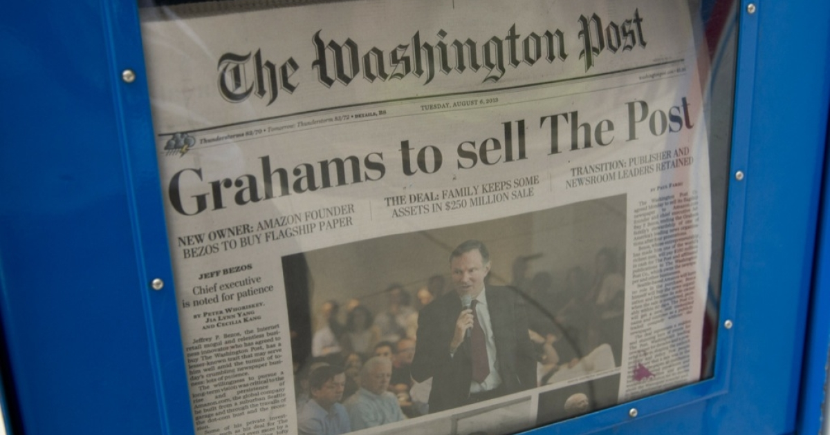 The front page of The Washington Post newspaper on August 6, 2013 in Washington, DC, the day after it was announced that Amazon.com founder and CEO Jeff Bezos had agreed to purchase the newspaper for $250 million from the Graham family. The sale marked the end of an era for one of American journalism's iconic brands.</p>