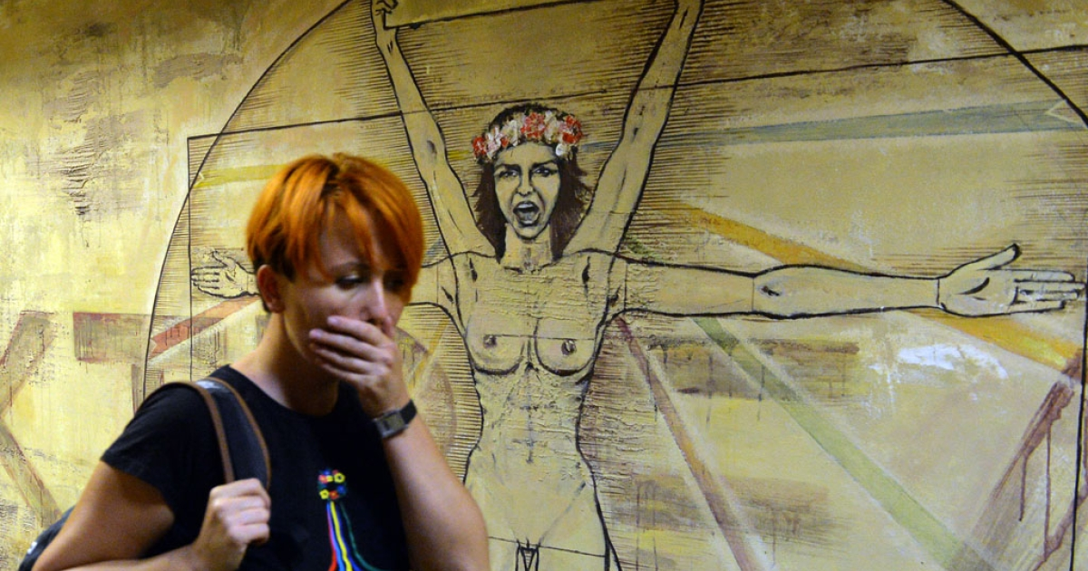 Femen leader Anna Hutsol leaves her Kiev office after a police search on Aug. 27, 2013. Police said they found a gun, grenade, portraits of Russian President Vladimir Putin and Patriarch Kirill. Hutsol said it was a provocation organized by the security services against the organization.</p>