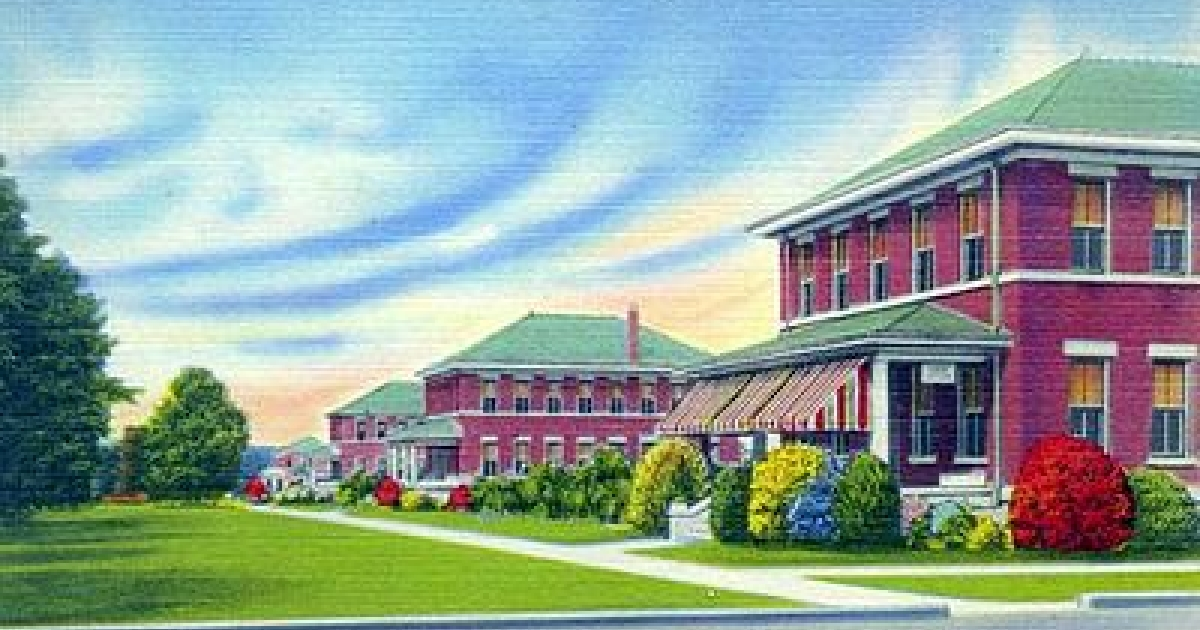 Postcard image of the Florida Industrial School for Boys in Marianna, FL.</p>