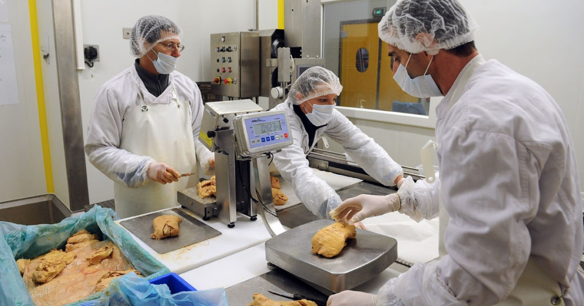 Workers prepare foie gras in a laboratory in Cahors, France, on February 28, 2013.</p>