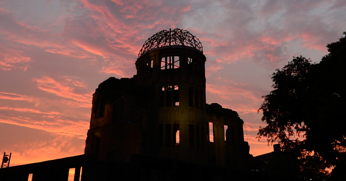 The Atomic Bomb Dome is seen in silhouette during sunset over the Peace Memoral Park in Hiroshima on August 5, 2013. Tens of thousands of people were expected to gather at a peace memorial park in Hiroshima on August 6 to mark the 68th anniversary of the US atomic bombing of the Japanese city.</p>