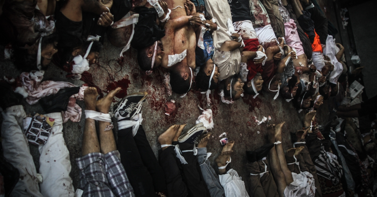 The bodies of pro-Morsi demonstrators are aligned on the floor of a makeshift morgue outside the Rabaa al-Adaweya mosque in Cairo, where supporters of the former president have staged a weeks-long sit-in. Security forces clamped down on the demonstration, and health officials say 149 people were killed in the ensuing violence.</p>