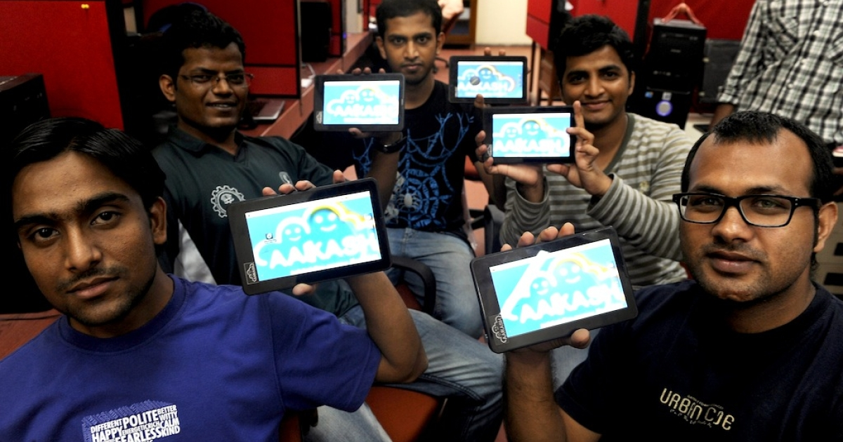 Indian engineers pose with the ultra-low cost Aakash-2 tablet in Mumbai on June 26, 2012.</p>