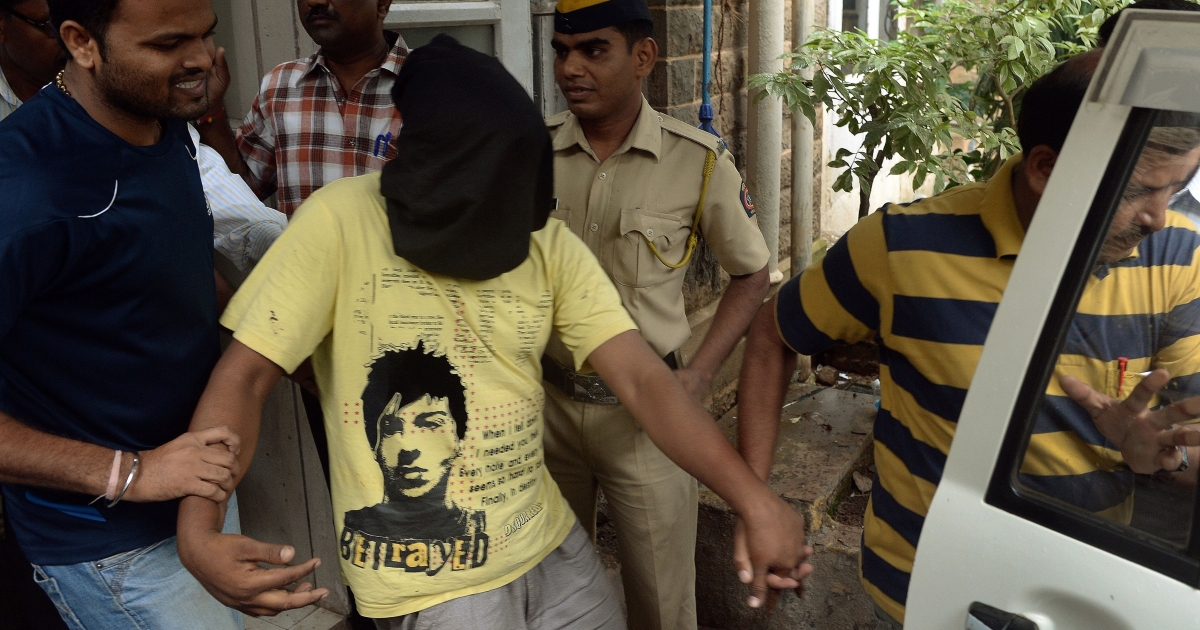 Indian police escort a suspect in the gang-rape of a photojournalist after his appearance at a court in Mumbai on Aug. 25, 2013.</p>