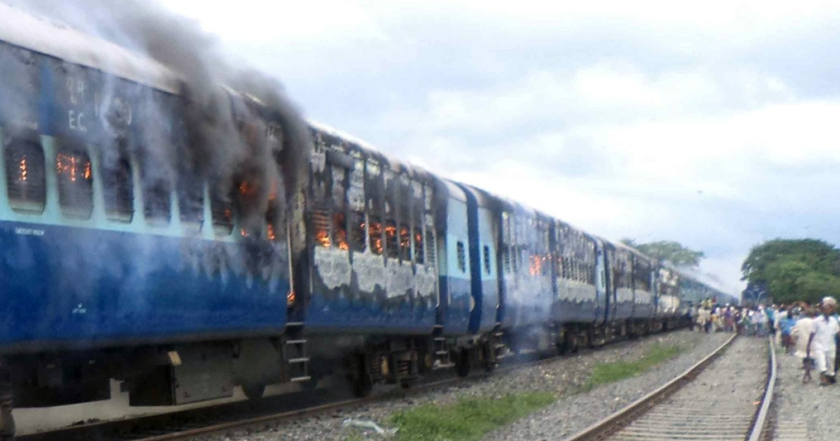 Coaches of the Rajya Rani Express, set on fire by an angry mob, burn after the train ran into a crowd of Hindu pilgrims at the Dhamara Ghat railway station in Khagaria district, some 154 miles from Bihar state capital Patna, on Aug. 19, 2013.</p>