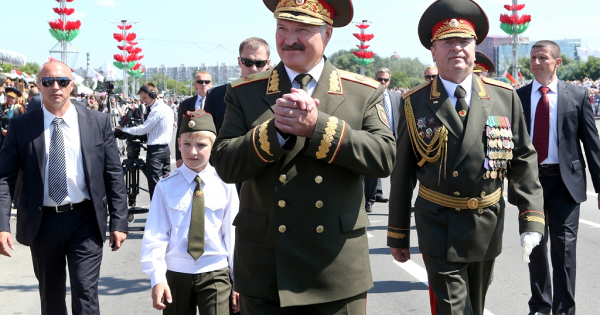 Belarus' president, Alexander Lukashenko, center, and his son Kolya attend Independence Day parade in Minsk, on July 3.</p>