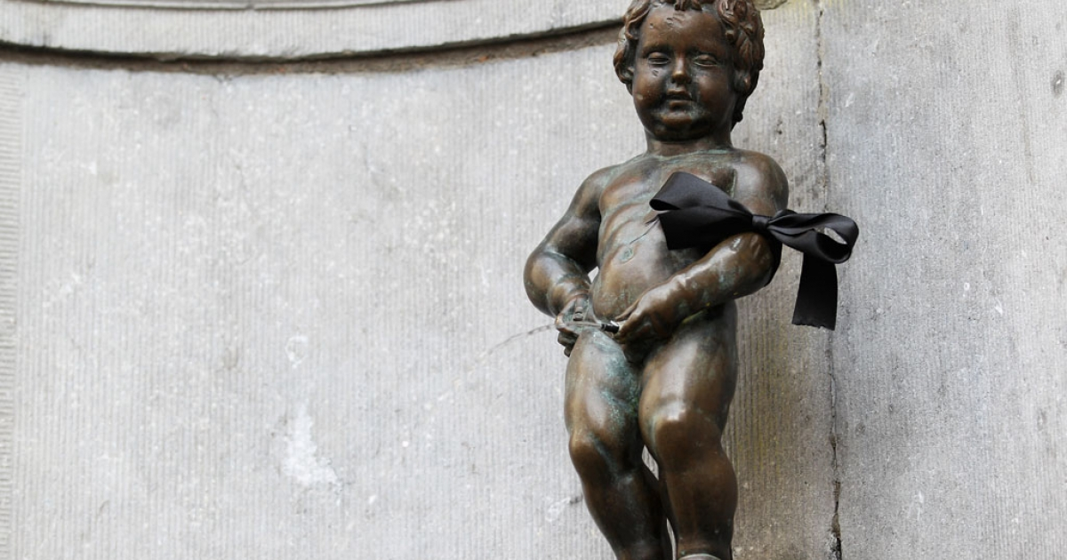 The Manneken Pis statue wears a black arm band in the city centre during a national day of mourning on March 16, 2012 in Heverlee, Belgium.</p>