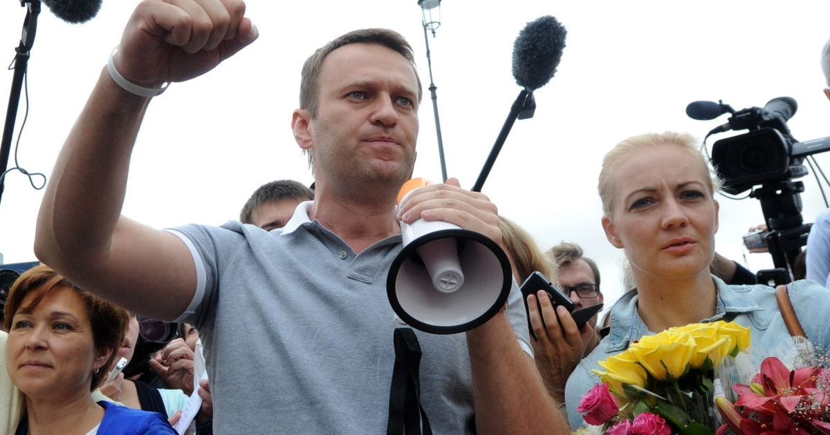 Navalny with his wife Yulia. The opposition leader has fought a Western-style campaign.</p>