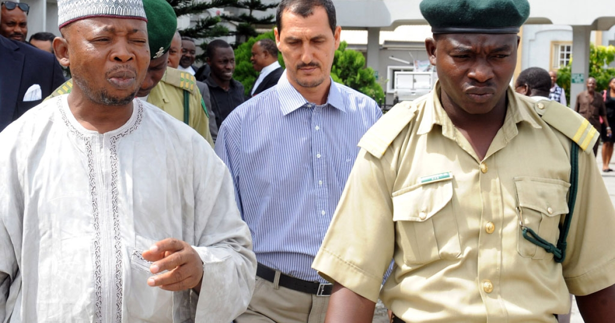 An alleged member of the Iranian Revolutionary Guard, Azim Aghajani and his Nigerian accomplice Ali Abbas Jega are led to prison on May 13, 2013 after being convicted for an illegal arms shipment in Lagos. Nigerian authorities are growing concerned about an apparent surge in interest in the West African country by Shia Muslim militant groups with links to Iran or Lebanon</p>