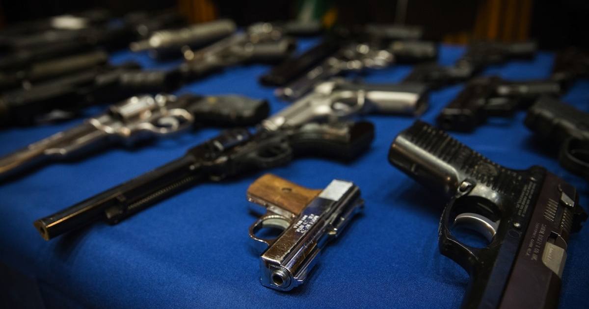 Weapons seized by the New York Police Department in the largest illegal guns bust in the city's history are displayed on a table during a press conference on August 19, 2013 in New York City.</p>