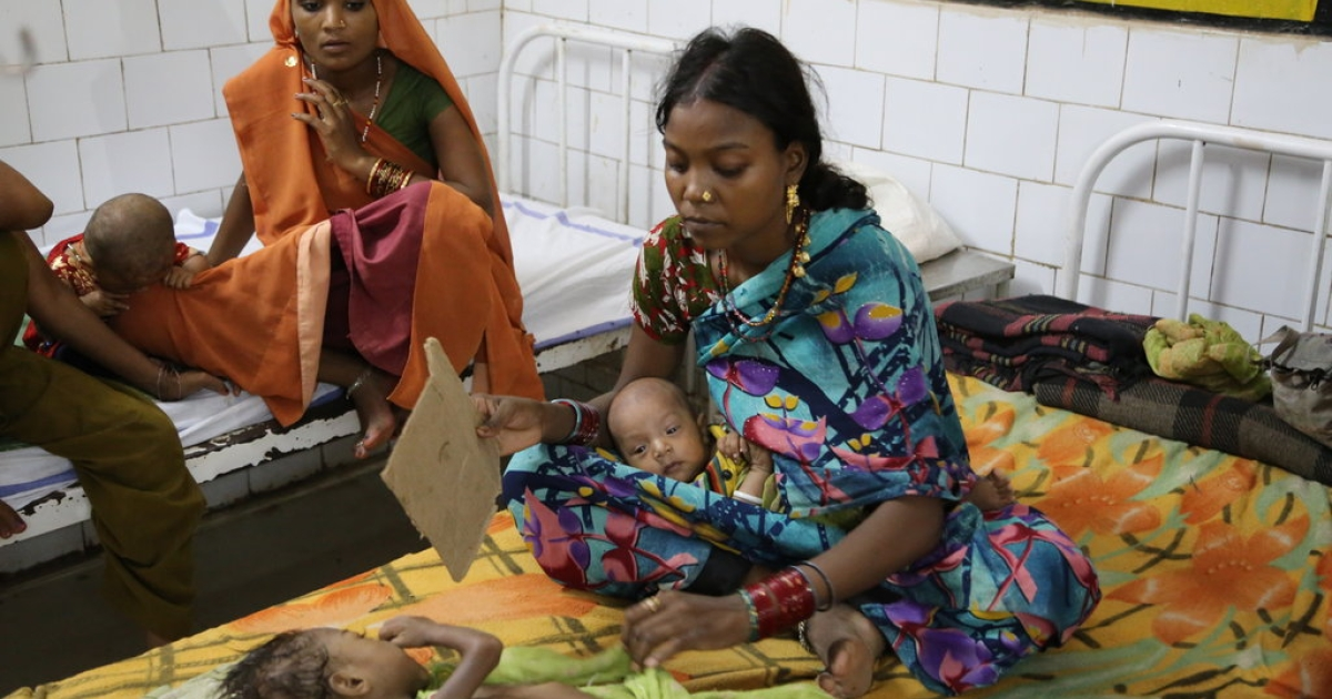 A mother uses a hand-fan for her 3-year-old daughter Deekhsha, suffering from chronic malnutrition at the District Hospital in Panna, Madhya Pradesh in Central India.</p>