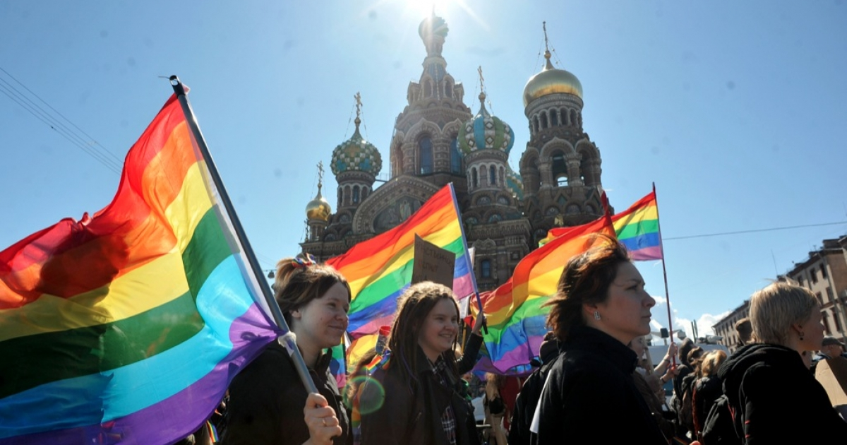 Gay rights activists march in Russia's second city of St. Petersburg May 1, 2013, during their rally against a controversial law in the city that activists see as violating the rights of gays.</p>