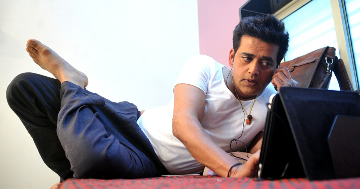 Indian Bollywood actor Ravi Kishan relaxes during filming on May 7, 2013.</p>