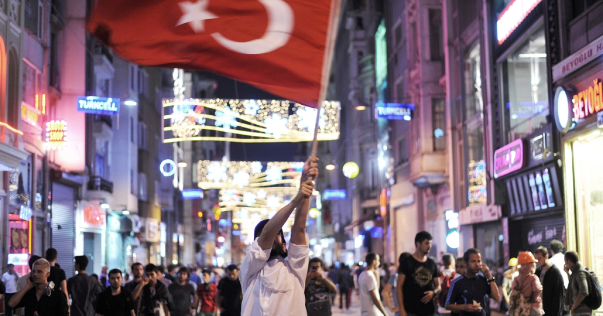 An anti-government demonstrator waves a flag on June 17, 2013 on Istikal street in the center of Istanbul.</p>