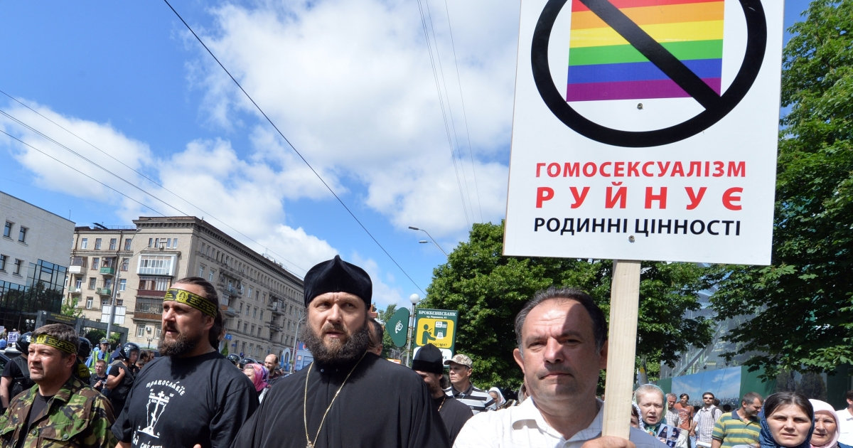 Anti-gay protesters in Kyiv. The sign reads
