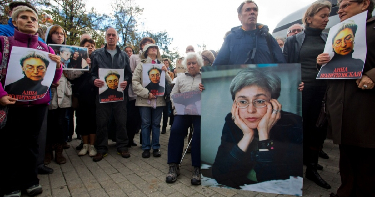 Demonstrators hold portraits of slain journalist Anna Politkovskaya during a rally marking the 6th anniversary of her death in central Moscow on Oct. 7, 2012.</p>